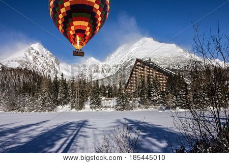 Hot air balloon in winter mountain landscape, Slovakia