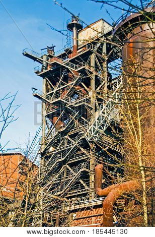 Industrial plant pipeline furnace in winter snow ice steel