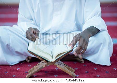 African Muslim Man Making Traditional Praying To God While Wearing A Traditional Cap Dishdasha