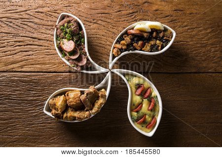 Four Typical Dishes Of The Brazilian Cuisine Called Tropeiro Beans, Torresmo, Polenta And Tutu Of Be