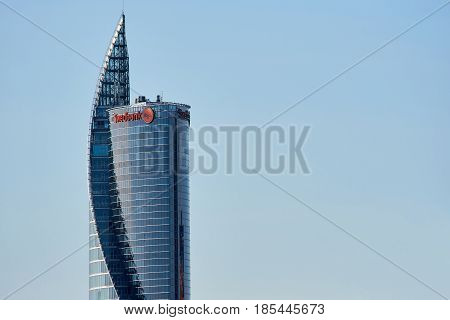 Riga Latvia - May 04 2017: Modern glass skyscraper of Swedbank office against blue sky in Riga city. Latvia Northern Europe