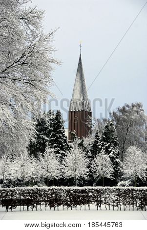 Sad white and grey winter scenary public park and church