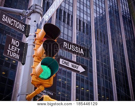 NYC Wall street yellow traffic light black pointer guide one way green light to Russia, no turn no way to Sanctions. Anti sanctions campaign propaganda. Way to dialogue with Russia. Dirty politics