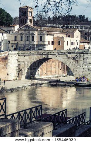 ROME, ITALY. February 02, 2016: Basilica St. Bartholomew, Pons Cestius, Tiber Island and river. Rome, Italy