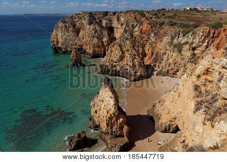 Rocky beach, Lagos, Portugal. Travel and business background