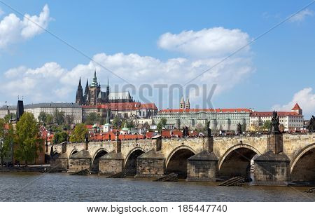 Prague, Czech Republic. Charles Bridge and Hradcany (Prague Castle) with St. Vitus Cathedral and St. George church.