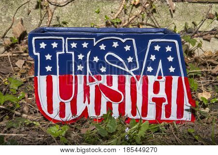 A patriotic planter decoration for the Fourth of July Holiday
