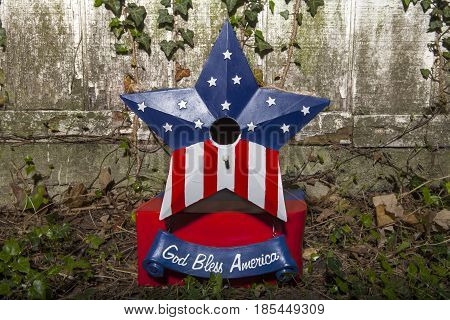 A patriotic birdhouse decoration for the Fourth of July Holiday