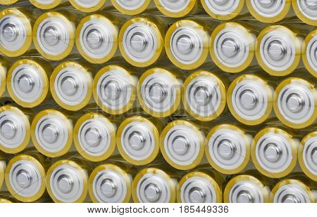 background from large group of gold batteries