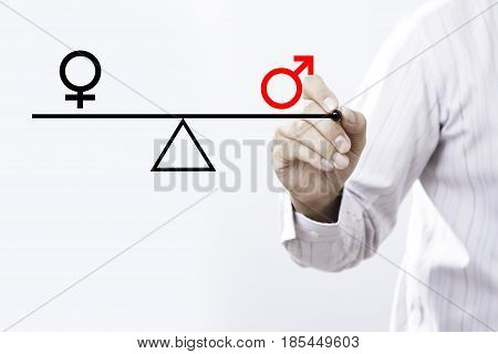 Businessman hand drawing male and female genetic symbols in equilibrium. Equality between the sexes.