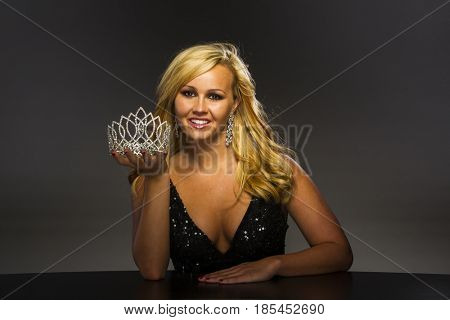 A beauty queen posing in a studio environment