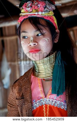 Thailand North Chiang Rai - January 2016: a girl of the Padaung tribe in a traditional national village.