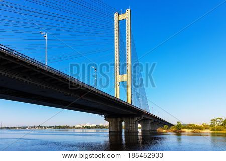 Scenic summer view of the Southern Bridge over Dnieper river in Kyiv, Ukraine