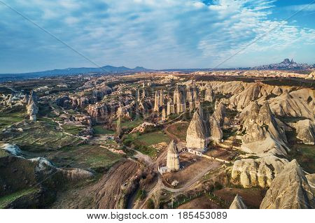 Aerial view of rock formations in Cappadocia Turkey.The Uchisar Castle Rock is visible in the background