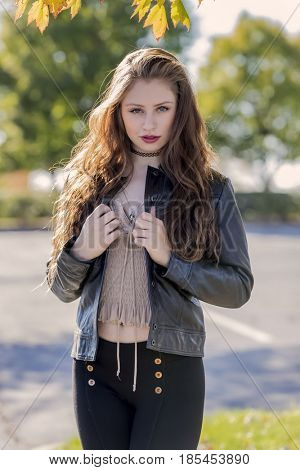 A brunette model enjoying the fall weather outdoors