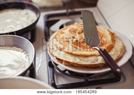 Making pancakes on the kitchen at home