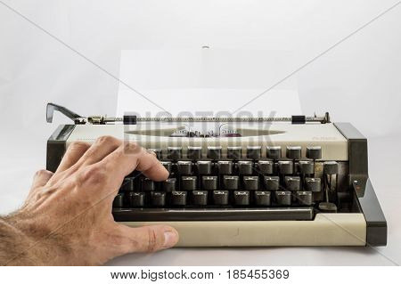 Old, Well-worn Typewriter On A White Isolated Background