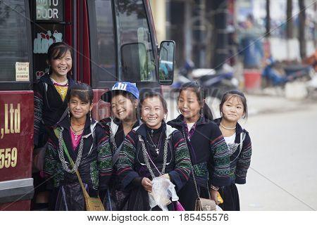 Sa Pa, Vietnam - 12 March, 2017: Ethnic minority, Hmong girls posing for a tourist in Sapa, Vietnam