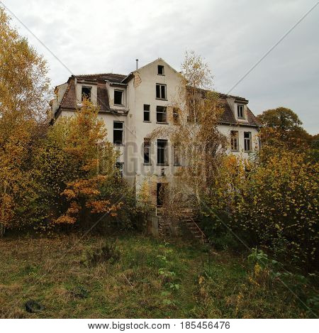 Ruined Sanatorium, Long Abandoned And Overgrown By Nature