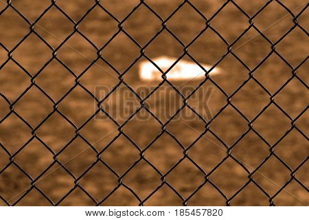 Baseball home plae and backstop chainlink fence wire