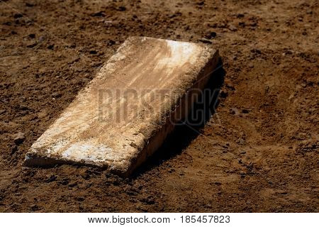 Old worn pitcher's mound baseball with fresh dirt
