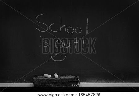 Chalkboard in school for education with eraser and chalk writing