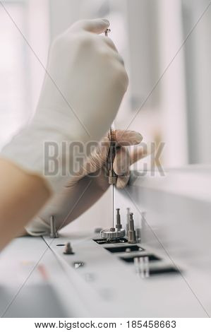 Female Researcher Doing Research In A Chemistry Lab. Gas Chromatograph