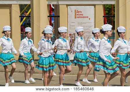 Lviv Ukraine - May 07. 2017: Band majorettes perform various dancing skills on city park the annual brass band exhibition in honor of the city day Lviv Ukraine .