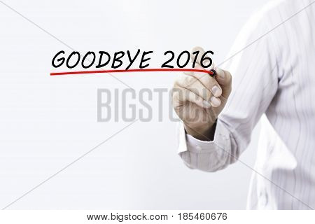 Businessman hand writing goodbye 2016 with red marker on transparent wipe board business concept