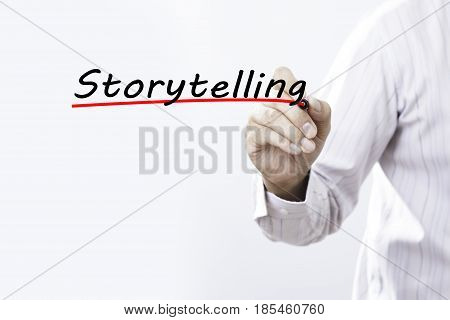 Businessman hand writing storytelling with red marker on transparent wipe board business concept