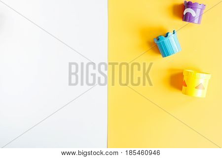 kid stylish set with toys white and yellow colored background top view mock-up