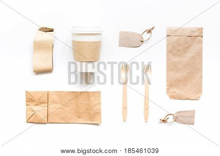 paper bags and tea bag for take away set on restourant white table background top view space for text