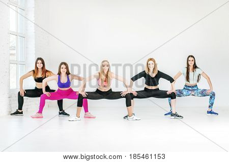Young people involved in fitness at the gym. The concept of sports dance yoga and healthy lifestyle.