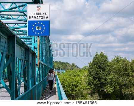 BRCKO BOSNIA AND HERZEGOVINA - MAY 6 2017: People entering the EU crossing the border between Bosnia and Croatia in Brcko. After the breakup of Yugoslavia this admistrative limit became a state border