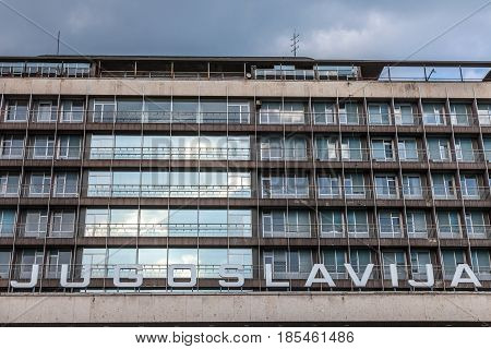 Picture of a Communist era building with the word Yugoslavia (Jugoslavia) written in front of it in Belgrade capital city of Serbia and former capital city of the Yugoslav Republic