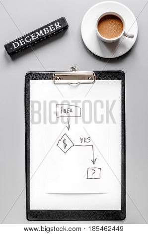 december business plan with sketch board, coffee and chart hand-drawn in management set on gray office table background top view