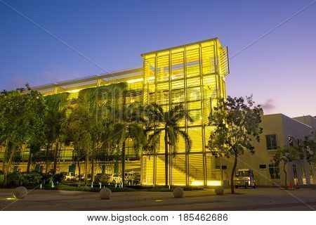 Colored yellow level parking at dusk in Camana Bay a waterfront town of Grand Cayman, Cayman Islands