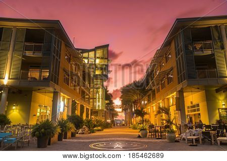 Sunset on a pedestrian street of a waterfront town in Grand Cayman