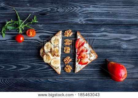 triangle sandwiches set on dark wooden table background top view space for text