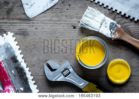builder work with professional repairing implements set for decorating and painting on wooden background top view