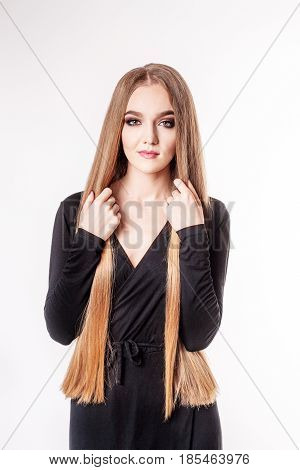Beautiful girl has very long hair. The concept model and beauty.