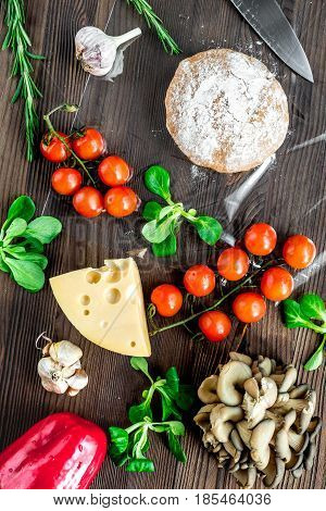 vegetables and cheese for cooking pizza on wooden kitchen table background top view