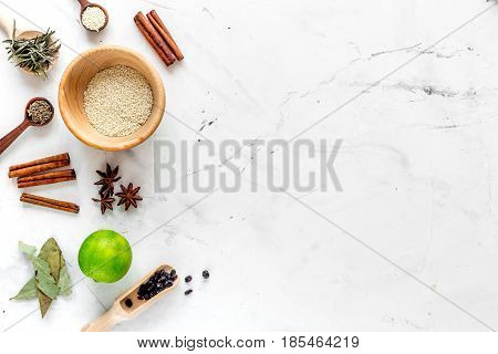 Flat lay vanilla, cinnamon, herb and spices on rustic white kitchen background space for text