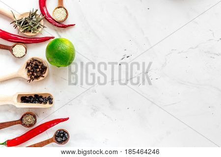 Flat lay herb and spices on rustic white kitchen background space for text