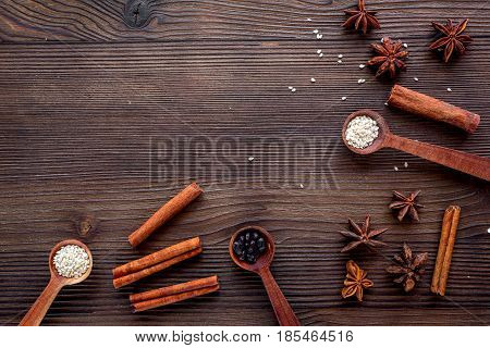 Dry colorful spices, vanilla, cinnamon for homemade dinner on kitchen wooden table background top view mockup