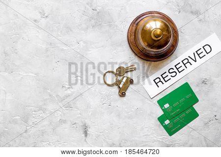 room reservation form on hotel reception desk background top view mock up