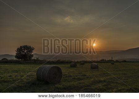 Orange sunset near Milada lake in north Bohemia
