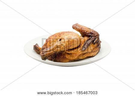 Grilled chicken isolated is placed in a white plate. On a white backgroundwith clipping path
