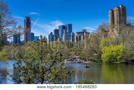 New York NY. USA - April 23 2017. People enjoy a beautiful Spring day in Central Park New York