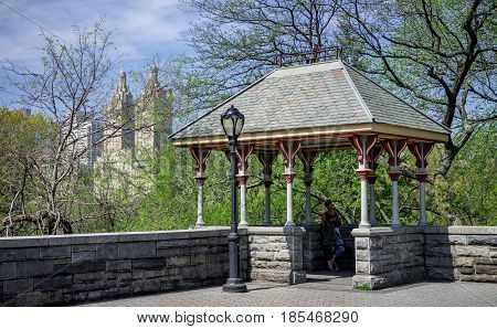 New York NY. USA - April 28 2017. A woman relaxing in shade area in Central Park Belvedere Castle